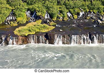 Hraunfossar - The spectacular Hraunfossar cascades, a...
