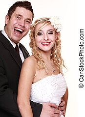 Portrait of happy bride and groom on white background -...