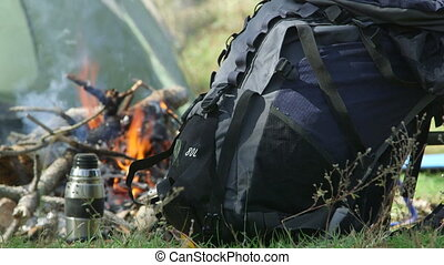 Backpack by campfire at the camp site