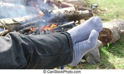Camping woman resting by campfire