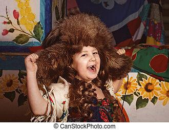 Beautiful little girl in winter hat
