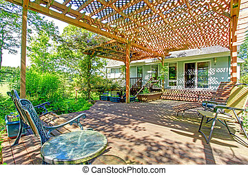 Backyard farm deck with attached open pergola - Great idea...