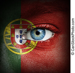 Human face painted with flag of Portugal
