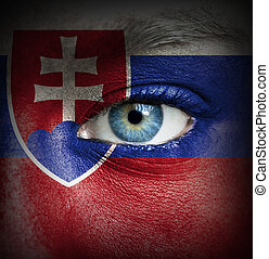 Human face painted with flag of Slovakia