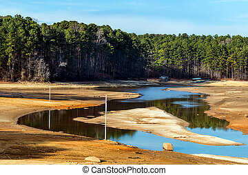 Dried up lake with docks on ground - Dried up lake with...