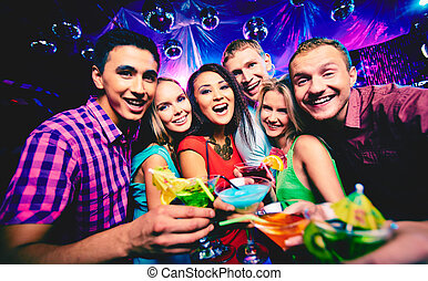 Friends toasting - Group of happy friends toasting with...