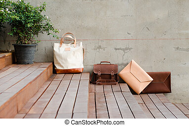 Fashion Leather Bags on grunge background - Fashion Leather...