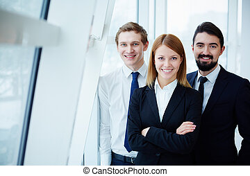 Business team - Three successful business partners looking...