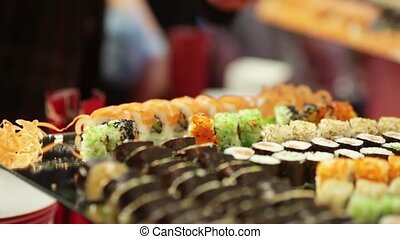 Sushi bar - Guests take sushi on a festive cocktail party
