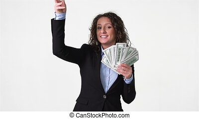 Wasting Money - Wealthy young woman throwing her money about