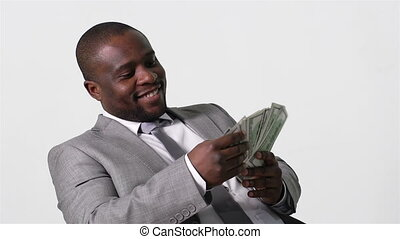 Counting Cash - Smiling business worker counting cash