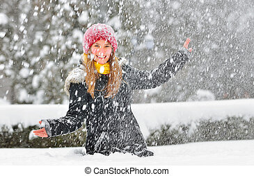 teenager girl play with snow in park