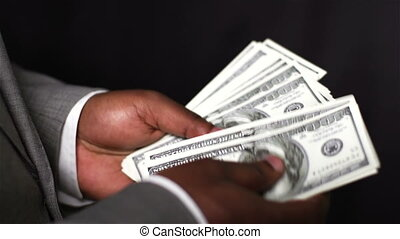 Bills In Hands - Close-up of an African-American businessman...