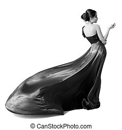 Fashion woman in fluttering dress. Black and white image....