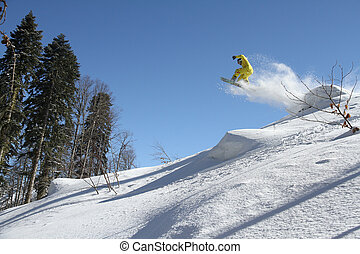 Snowboard freerider in the mountains