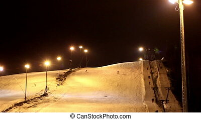 The view of a ski resort at night - The view of the ski...