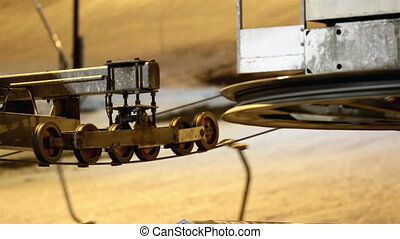 A huge and six small pulleys are rolling - A huge and the...