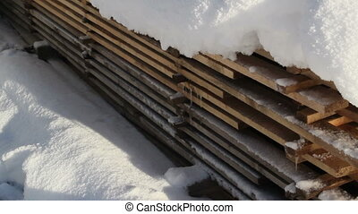 Pile of blocks filled with snow