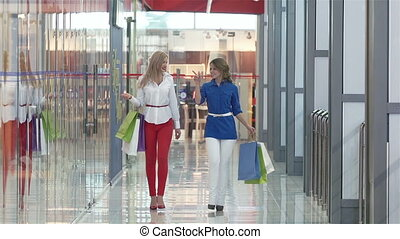 Shoppers - Friendly shoppers spending their time together...