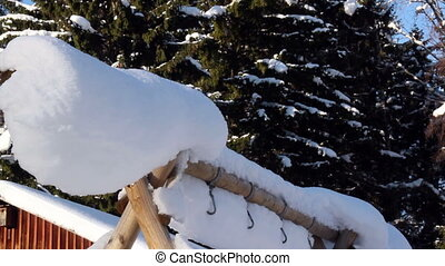 A triangle pole covered with snow