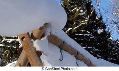 A triangular pole with hooks