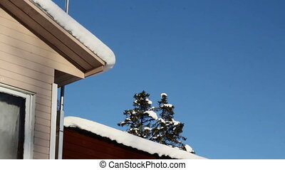 Rooftop and antenna are covered with snow - The houses...