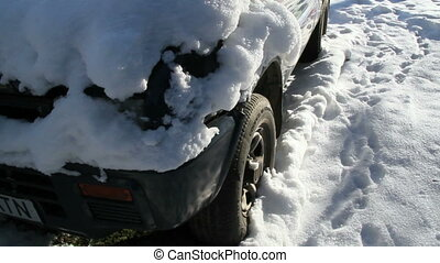 A parking car is covered with snow - A car parking outside...
