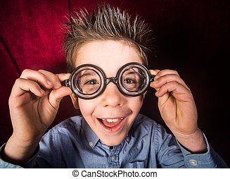 Child with big glasses - Smiled child with big glasses. Red...