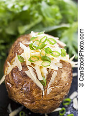 Baked Potato Stuffed with Cheese and Onions.