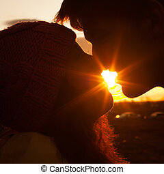 Silhouette of young man and woman in love