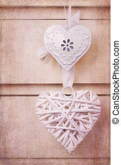Vintage hearts with texture - A wicker and a tin heart...