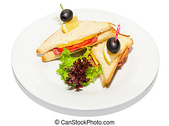 Sandwich with ham, cheese, lettuce and olive on plate,...
