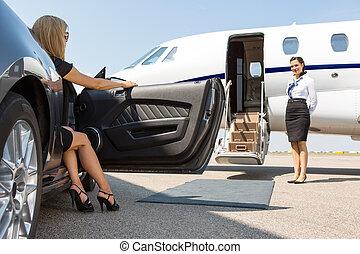 Elegant Woman Stepping Out Of Car At Terminal - Elegant...