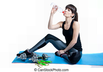 Sports woman drinking water - Pretty sporty young slim fit...
