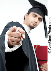 young boy graduated pointing finger in the camera to...