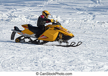 Snowmobile Racing - A snowmobilier takes a sharp turn...