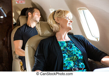 Business People Relaxing On Private Jet - Happy mature...