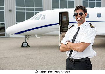 sonriente, piloto, posición, en, frente, de, privado,...