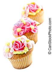 Cupcakes - Row of tasty cupcakes with icing flowers