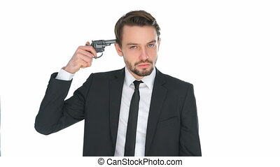 Suicidal businessman holding a gun to his head conceptual of...