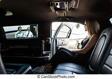 Elegant Woman In Limousine At Airport Terminal - Elegant...