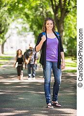 Confident Female Grad Student Outdoors - Full length...