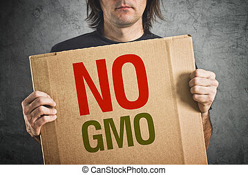 No GMO Man holding banner with Anti GMO message