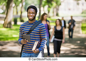 Happy Student Holding Digital Tablet On Campus - Portrait of...