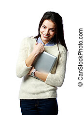 Young smiling businesswoman holding tablet computer isolated on a white background