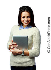 Young cheerful businesswoman holding tablet computer isolated on a white background
