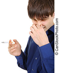 Young Man hates smoking - Displeased Young Man with...