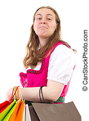 Young woman in dirndl addicted to shopping