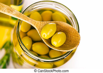 Close up green olives in bank isolated on the white