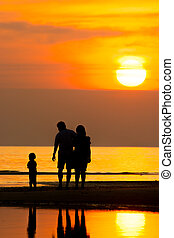 silhouette life - Silhouette of family on the beach during...